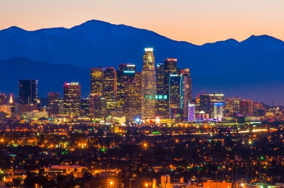 Downtown Los Angeles skyline at dawn with Mount Baldy (a.k.a. Mount San Antonio) in the background.